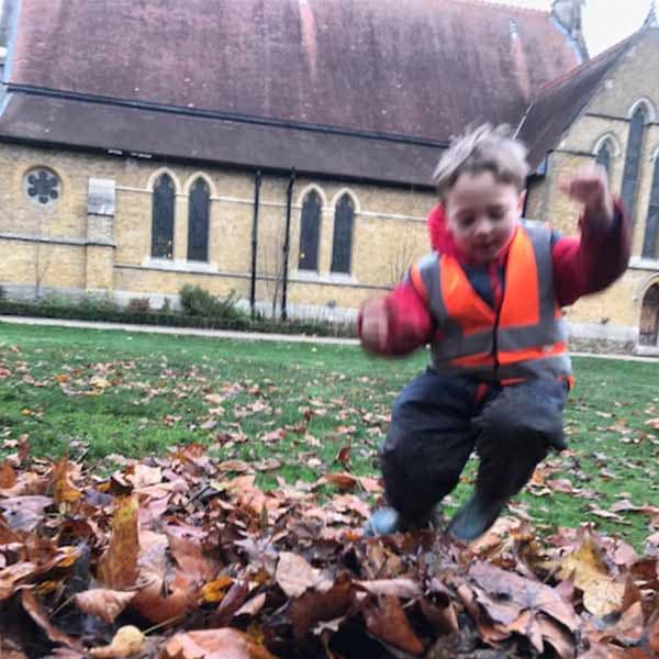Unique Expressions Wild About Play Forest School Nursery and After School Clubs Jumping in leaves