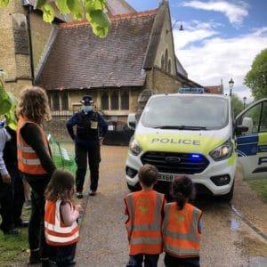 children looking at police van